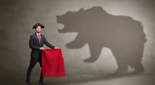 A matador duels with the shadow of a bear. Market conditions have been bearish and volatile.