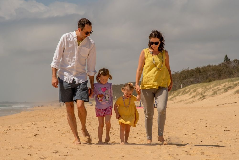 Claire Kidd with family on beach Six Park