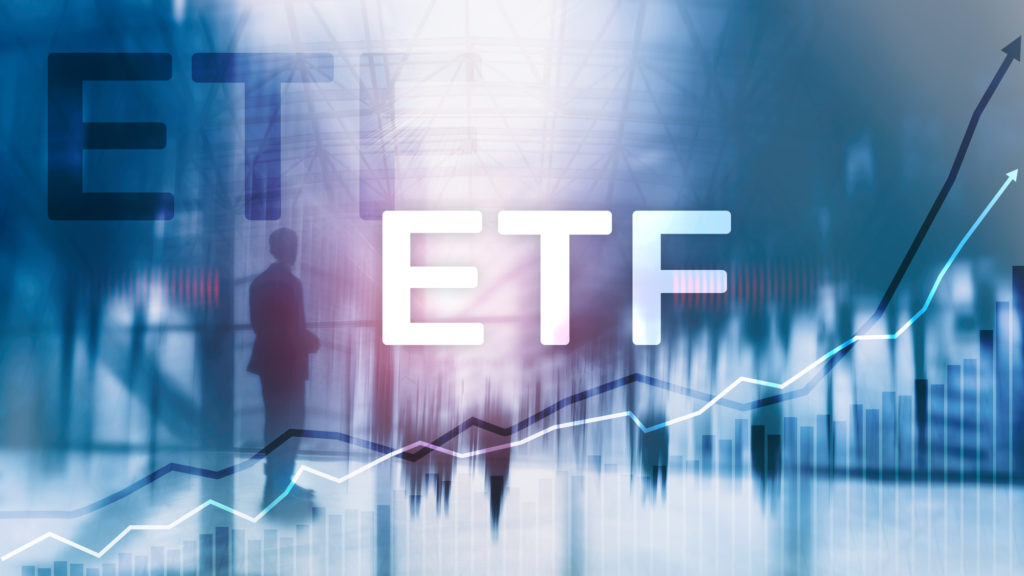 Image of ETF in front of people and graph